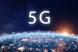 5G mobile internet telecommunication network with high speed wireless data connection technology for smartphones and IoT. Fifth generation system deployment concept with Earth viewed from space