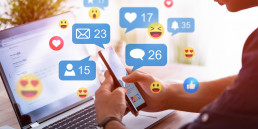 Like and share social media. Hands holding smartphone with social media network icons. Marketing concept.
